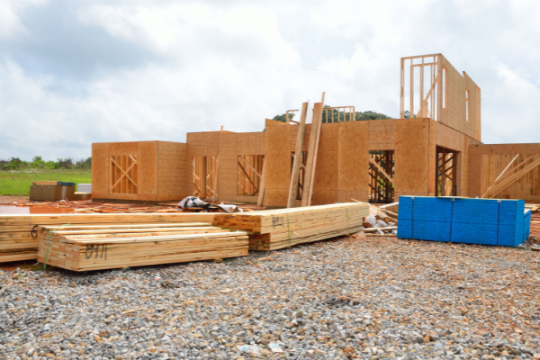 Residential construction site with unfinished home and lumber