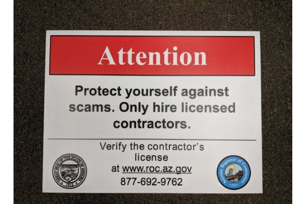 Sign that reads protect yourself against scams. Only hire licensed contractors.